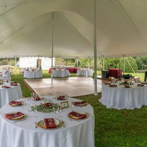 table settings in tented wedding event